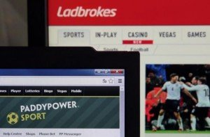 Picture illustration taken in Paris shows the Ladbrokes and PaddyPower Sport betting websites on electronic devices